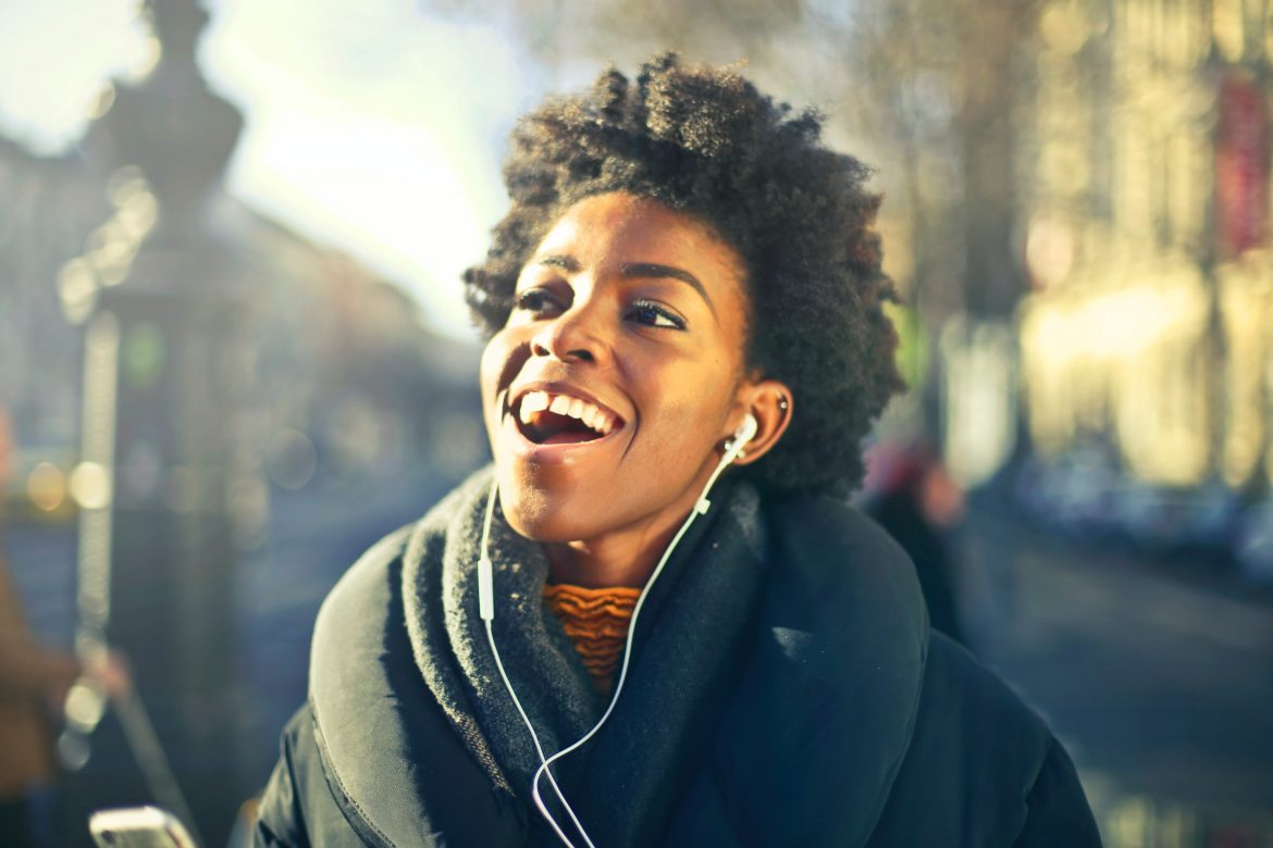 Woman listening to music/ Pexels
